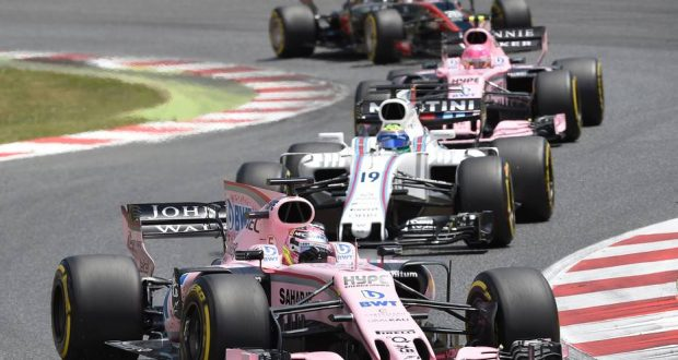 Force India's Mexican driver Sergio Perez (L) Williams' Brazilian driver Felipe Massa (C) and Force India's French driver Esteban Ocon, Haas F1's Danish driver Kevin Magnussen (TOP) race at the Circuit de Catalunya on May 14, 2017 in Montmelo on the outskirts of Barcelona during the Spanish Formula One Grand Prix. / AFP PHOTO / LLUIS GENE