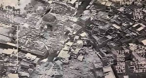 """(FILES) This aerial view taken on June 21, 2017 and provided by Iraq's Joint Operation Command reportedly shows destruction inside Mosul's Nuri mosque compound. Jihadists blew up Mosul's iconic leaning minaret and the adjacent Nuri mosque where their leader Abu Bakr al-Baghdadi declared a """"caliphate"""" in his only public appearance in 2014, an Iraqi commander said. The Islamic State group swiftly issued a statement via its Amaq propaganda agency blaming a US strike for the destruction of the Nuri mosque and the historic leaning Hadba minaret in its vicinity.  / AFP PHOTO / Joint Operation Command / HO"""