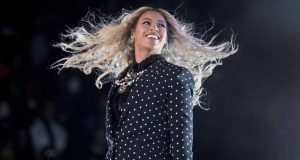 FILE - This Nov. 4, 2016, file photo shows Beyonce performing at a Get Out the Vote concert for Democratic presidential candidate Hillary Clinton in Cleveland. Forbes announced on Nov.  20, 2017, that Beyonce was the highest earning woman in the music industry. The outlet says she earned $105 million over a year-long period that ended in June. (AP Photo/Andrew Harnik, File)