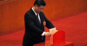 Chinese President Xi Jinping cast his vote for an amendment to China's constitution that will abolish term limits on the presidency and enable him to rule indefinitely, during a plenary session of the National People's Congress at the Great Hall of the People in Beijing, Sunday, March 11, 2018. (AP Photo/Andy Wong)
