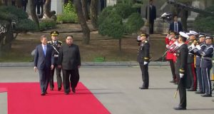 South Korean President Moon Jae-in and North Korean leader Kim Jong Un at a welcome ceremony at the inter-Korean summit at the truce village of Panmunjom, in this still frame taken from video, South Korea April 27, 2018. Host Broadcaster via REUTERS TV  ATTENTION EDITORS - THIS IMAGE HAS BEEN PROVIDED BY A THIRD PARTY. NO RESALES. NO ARCHIVES. SOUTH KOREA OUT.