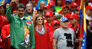 Venezuela's President Nicolas Maduro, his wife Cilia Flores and former Argentinian soccer player Diego Armando Maradona greet supporters during a campaign rally in Caracas, Venezuela May 17, 2018. REUTERS/Carlos Garcia Rawlins