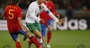 Portugal's striker Cristiano Ronaldo (C) is challenged for the ball by Spain's midfielder Sergio Busquets (back) and Spain's defender Carles Puyol during the 2010 World Cup round of 16 football match Spain vs. Portugal on June 29, 2010 at Green Point stadium in Cape Town.  NO PUSH TO MOBILE / MOBILE USE SOLELY WITHIN EDITORIAL ARTICLE -      AFP PHOTO / KARIM JAAFAR