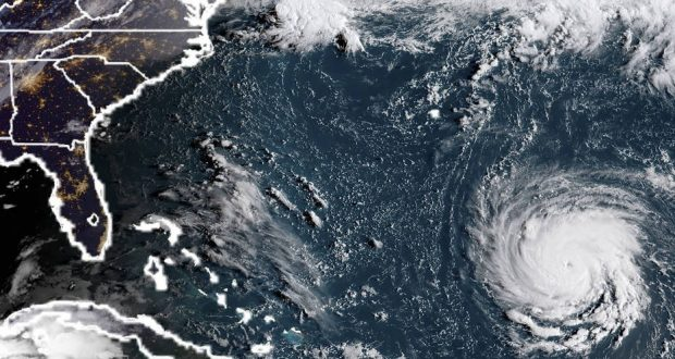 """TOPSHOT - This NOAA/RAMMB satellite image taken at 11:45 UTC on September 10, 2018, shows Hurricane Florence off the US east coast in the Atantic Ocean. - Hurricane Florence is expected to become a dangerous """"major hurricane"""" by late Monday as it heads toward the US East Coast, the National Hurricane Center said, as states of emergency were declared in preparation for the storm. The center of Florence was located about 685 miles (1,100 kilometers) southeast of Bermuda, the NHC in its 0300 GMT Monday advisory.Florence had maximum sustained winds of 90 miles per hour, making it a Category 1 storm on the five-level Saffir-Simpson hurricane scale. (Photo by HO / NOAA/RAMMB / AFP) / RESTRICTED TO EDITORIAL USE - MANDATORY CREDIT """"AFP PHOTO / NOAA/RAMMB"""" - NO MARKETING NO ADVERTISING CAMPAIGNS - DISTRIBUTED AS A SERVICE TO CLIENTS"""