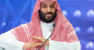 "A handout picture provided by the Saudi Royal Palace on October 24, 2018, shows Saudi Crown Prince Mohammed bin Salman speaking during a joint session of the Future Investment Initiative (FII) conference in the capital Riyadh, which included the Crown Prince of Bahrain and the Lebanese Prime Minister. (Photo by Bandar AL-JALOUD / Saudi Royal Palace / AFP) / RESTRICTED TO EDITORIAL USE - MANDATORY CREDIT ""AFP PHOTO / SAUDI ROYAL PALACE / BANDAR AL-JALOUD"" - NO MARKETING - NO ADVERTISING CAMPAIGNS - DISTRIBUTED AS A SERVICE TO CLIENTS"