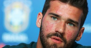 SOCHI, RUSSIA - JUNE 12:  Goalkeeper Alisson attends the media during a Brazil press conference ahead of the FIFA World Cup 2018 in Russia at Yug-Sport Stadium on June 12, 2018 in Sochi, Russia.  (Photo by Buda Mendes/Getty Images)