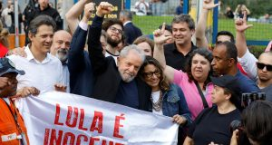 "Former Brazilian President Luiz Inacio Lula da Silva gestures behind a banner reading ""Lula is innocent"" after being released from prison, in Curitiba, Brazil November 8, 2019. REUTERS/Rodolfo Buhrer"