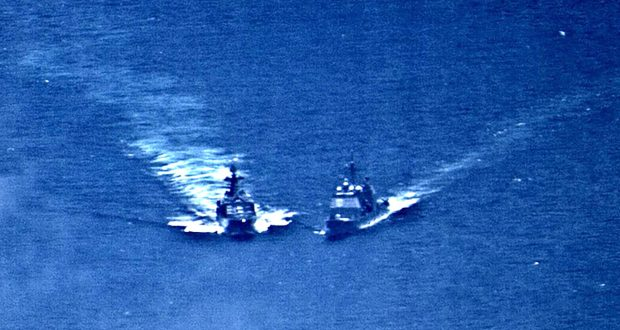 A surveillance photo shows the Russian naval destroyer Udaloy making what the U.S. Navy describes as an unsafe maneuver against the Ticonderoga-class guided-missile cruiser USS Chancellorsville in the Philippine Sea June 7, 2019.  U.S. Navy/Handout via REUTERS.  ATTENTION EDITORS - THIS IMAGE WAS PROVIDED BY A THIRD PARTY.