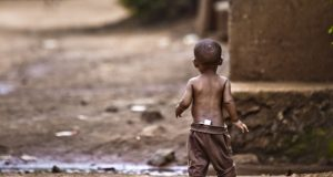 Orphan boy in an impoverished African village.